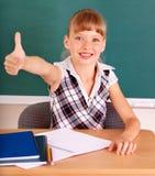 Schoolchild in classroom near blackboard. Royalty Free Stock Images