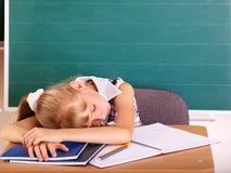Schoolchild in classroom near blackboard. Stock Photography