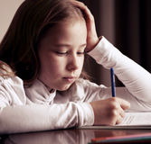 Schoolchild  doing homework Royalty Free Stock Photos