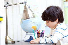 Schoolchild doing homework Stock Photography