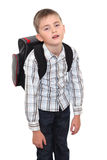Schoolchild with a heavy satchel on shoulders. Royalty Free Stock Image