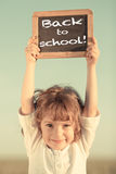 Schoolchild holding small blackboard Royalty Free Stock Photo
