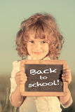Schoolchild holding small blackboard Royalty Free Stock Image