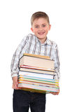 The schoolchild with a huge pile of books Royalty Free Stock Photo