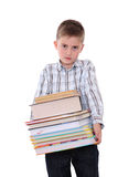 The schoolchild with a huge pile of books Royalty Free Stock Photography