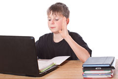 Schoolchild learns lessons royalty free stock image