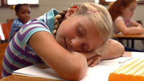 Schoolchild napping on notepad at school stock footage