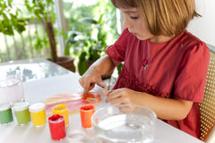 Schoolchild painting with hands Royalty Free Stock Photo
