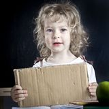 Schoolchild with paper blank Stock Image