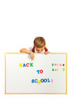 Schoolchild pointing to banner Stock Images