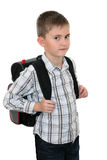 Schoolchild with a schoolbag on shoulders Royalty Free Stock Photos
