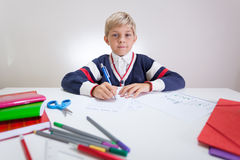 Schoolchild at the sweater doing wordsearch Stock Photography