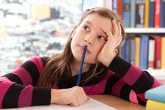 Schoolchild thinking while doing homework Royalty Free Stock Photos