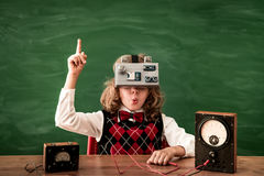 Schoolchild with virtual reality headset in class Stock Photos