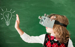 Schoolchild with virtual reality headset in class Royalty Free Stock Photos