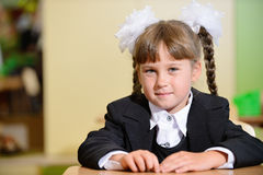 Schoolchild with white bows and black suite Royalty Free Stock Photos