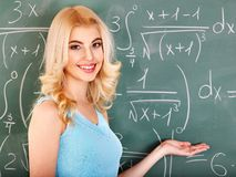 Schoolchild writing on blackboard. Royalty Free Stock Photo
