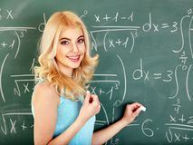Schoolchild writing on blackboard. Stock Photography