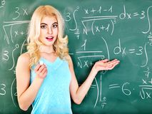 Schoolchild writing on blackboard. Royalty Free Stock Images