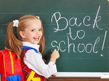 Schoolchild writting on blackboard. Stock Images