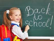 Schoolchild writting on blackboard. Stock Images