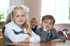 Schoolchildren. Sit at a school desk Royalty Free Stock Image