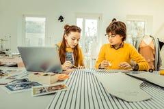Schoolchildren attending creative design school after classes. After classes. Smart and active schoolchildren attending creative design school after classes stock photos