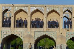 Schoolchildren Boys are in niches Khaju bridge, Isfahan, Iran. Isfahan, Iran - April 24, 2017: A group of school boys is in the niches of the upper tier of the stock images