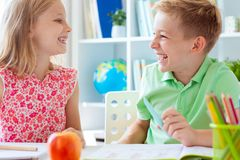 Schoolchildren are came back to school and learning at the table in classroom royalty free stock photography