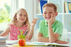 Schoolchildren are came back to school and learning at the table in classroom royalty free stock images