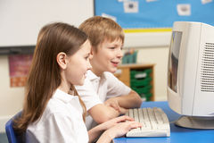 Schoolchildren In IT Class Using Computer Royalty Free Stock Photography