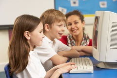 Schoolchildren In IT Class Using Computer Royalty Free Stock Photos