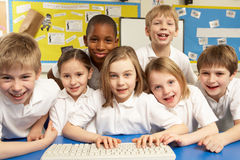 Schoolchildren in IT Class Using Computers Royalty Free Stock Photos