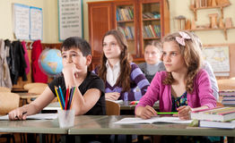Schoolchildren at classroom during a lesson Royalty Free Stock Photography
