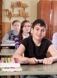 Schoolchildren at classroom during a lesson Royalty Free Stock Images