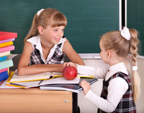 Schoolchildren in classroom near blackboard. Royalty Free Stock Photography