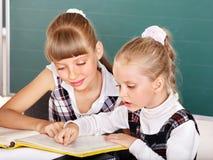 Schoolchildren in classroom near blackboard. Stock Photography