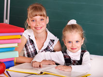 Schoolchildren in classroom near blackboard. Royalty Free Stock Photography
