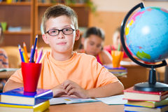 Schoolchildren in classroom at school Royalty Free Stock Images