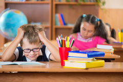 Schoolchildren in classroom at school Stock Photo