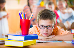 Schoolchildren in classroom at school Royalty Free Stock Images