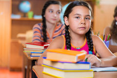 Schoolchildren in classroom at school Stock Photography
