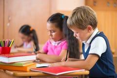 Schoolchildren in classroom at school Stock Photos
