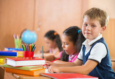 Schoolchildren in classroom at school Royalty Free Stock Image