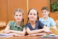 Schoolchildren in classroom Stock Images