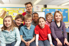 Schoolchildren In classroom with teacher Royalty Free Stock Photo