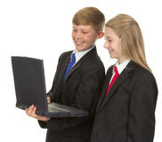 Schoolchildren with a computer Royalty Free Stock Image