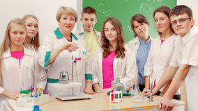 Schoolchildren doing experiment in science class Royalty Free Stock Image