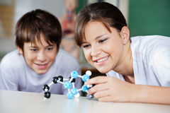 Schoolchildren Examining Molecular Structure Stock Photography