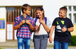 Schoolchildren, friends walking from school, fellow sympathy Stock Photo